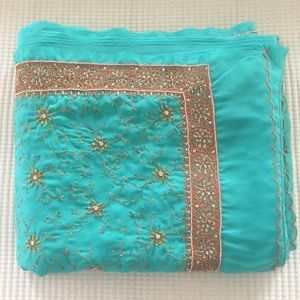 Beautiful embroidered green chiffon saree